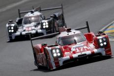 Timo Bernhard of Germany drives his Porsche 919 Hybrid number 17 during the Le Mans 24-hour sportscar race in Le Mans, central France June 13, 2015. The Porsche 919 Hybrid number 17 is also driven by Brendon Hartley of New Zealand and Mark Webber of Australia. REUTERS/Stephane Mahe