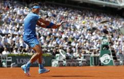 Rafael Nadal of Spain returns the ball to Novak Djokovic of Serbia during their men's quarter-final match during the French Open tennis tournament at the Roland Garros stadium in Paris, France, June 3, 2015.     REUTERS/Vincent Kessler