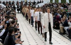 """Models present creations from the Burberry Spring/Summer 2015 collection during """"London Collections: Men"""" in London, Britain June 15, 2015.  REUTERS/Suzanne Plunkett"""