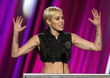 Singer Miley Cyrus inducts Joan Jett and the Blackhearts during the 2015 Rock and Roll Hall of Fame Induction Ceremony in Cleveland, Ohio April 18, 2015. REUTERS/Aaron Josefczyk