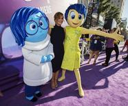 """Cast member Amy Poehler (C) poses with the characters of Sadness and Joy (R) at the premiere of """"Inside Out"""" at El Capitan theatre in Hollywood, California June 8, 2015. The movie opens in the U.S. on June 19.  REUTERS/Mario Anzuoni"""