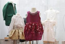 A pink Mischka Aoki dress donated by Victoria Beckham previously worn by her daughter Harper Beckham, is displayed at Mary's Living & Giving shop in the Primrose Hill neighbourhood of London, Britain June 16, 2015. REUTERS/Suzanne Plunkett -