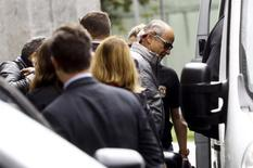 Andrade Gutierrez CEO Otavio Marques Azevedo (R) leaves the Federal Police headquarters in Sao Paulo, Brazil, June 19, 2015. REUTERS/Francio de Holanda