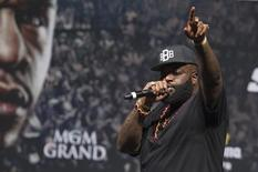 Rapper Rick Ross performs during an official weigh-in ceremony for the welterweight boxing match between Floyd Mayweather Jr. of the U.S. and Marcos Maidana of Argentina at the MGM Grand Garden Arena in Las Vegas, Nevada September 12, 2014.     REUTERS/Steve Marcus