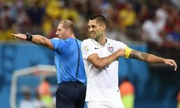 Clint Dempsey of the U.S. adjusts his captain armband as referee Nestor Pitana of Argentina gestures in the background during their 2014 World Cup G soccer match against Portugal at the Amazonia arena in Manaus June 22, 2014. REUTERS/Dylan Martinez