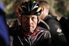 Seven-time Tour de France winner Lance Armstrong awaits the start of the 2010 Cape Argus Cycle Tour in Cape Town March 14, 2010.   REUTERS/Mike Hutchings