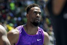Tyson Gay of the U.S. reacts after winning the 100m at the IAAF Diamond League Grand Prix track and field competition in New York June 13, 2015. REUTERS/Eduardo Munoz