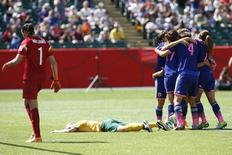 Jun 27, 2015; Edmonton, Alberta, CAN; Japan forward Mana Iwabuchi (16) celebrates scoring against Australia with teammates during the second half in the quarterfinals of the FIFA 2015 Women's World Cup at Commonwealth Stadium. Japan won 1-0. Mandatory Credit: Erich Schlegel-USA TODAY Sports