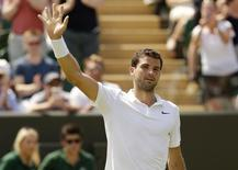 Grigor Dimitrov of Bulgaria celebrates after winning his match against Steve Johnson of the U.S.A. at the Wimbledon Tennis Championships in London, July 1, 2015.       REUTERS/Henry Browne