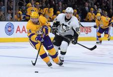 Los Angeles Kings right wing Justin Williams (74) is defended by Pittsburgh Penguins center Sidney Crosby (87) at Staples Center. The Penguins defeated the Kings 1-0 in overtime. Kirby Lee-USA TODAY Sports