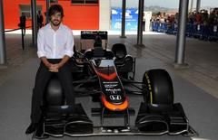 McLaren Formula One driver Fernando Alonso of Spain poses for the media during the inauguration of the Fernando Alonso Museum in Llanera, northern Spain June 26, 2015. REUTERS/Eloy Alonso