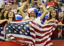 Jun 30, 2015; Montreal, Quebec, CAN; United States fans cheer after the semifinals against Germany in the FIFA 2015 Women's World Cup at Olympic Stadium. United States defeated Germany 2-0. Mandatory Credit: Jean-Yves Ahern-USA TODAY Sports