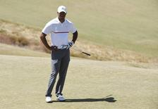 Jun 19, 2015; University Place, WA, USA; Tiger Woods reacts on the 2nd green in the second round of the 2015 U.S. Open golf tournament at Chambers Bay.  Kyle Terada-USA TODAY Sports