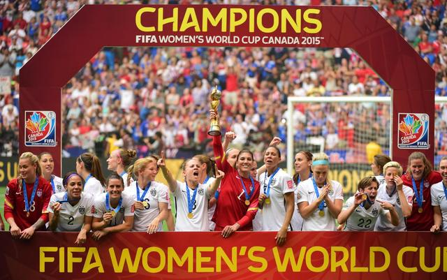 United States goalkeeper Hope Solo (1) hoists the FIFA Women's World Cup trophy as she and her teammates pose with their medals after defeating Japan in the final of the FIFA 2015 Women's World Cup in Vancouver July 5, 2015.  Mandatory Credit: Anne-Marie Sorvin-USA TODAY Sports
