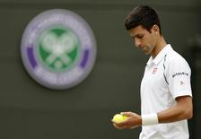 Novak Djokovic of Serbia prepares to serve during his match against Kevin Anderson of South Africa at the Wimbledon Tennis Championships in London, July 7, 2015.                       REUTERS/Henry Browne