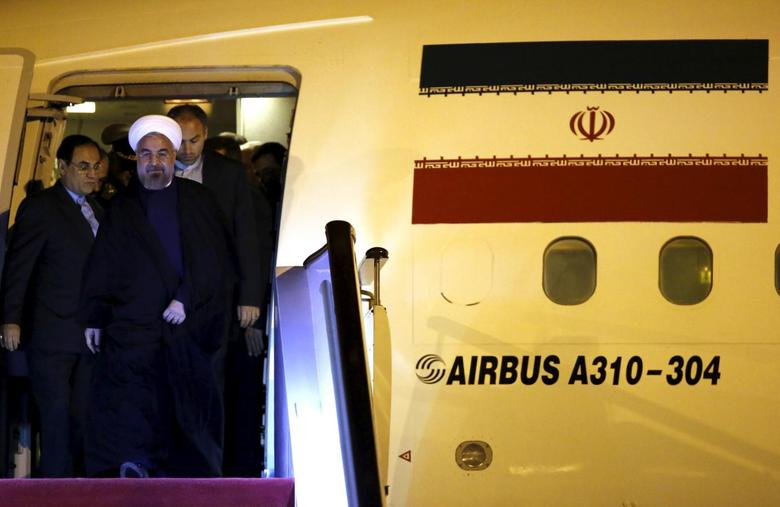 Iran's President Hassan Rouhani arrives at Pudong International Airport, ahead of the fourth Conference on Interaction and Confidence Building Measures in Asia (CICA) summit in Shanghai, China, in this May 20, 2014 file photo. REUTERS/Carlos Barria/Files