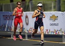 Jul 11, 2015; Toronto, Ontario, CAN; Barbara Riveros of Chile leads Flora Duffy of Bermuda during the running portion in the Triathlon during the 2015 Pan Am Games at Ontario Place West Channel. Mandatory Credit: Jeff Swinger-USA TODAY Sports