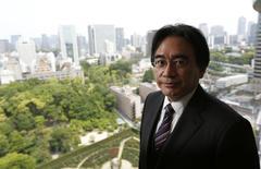 Le directeur général de Nintendo, Satoru Iwata, est mort samedi à l'âge de 55 ans d'une longue maladie, a annoncé lundi le groupe japonais spécialisé dans les jeux électroniques. /Photo prise le 8 mai 2014/REUTERS/Toru Hanai