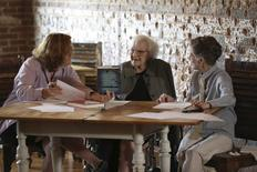 """American author Harper Lee speaks with documentary filmmaker and author Mary McDonagh Murphy (L) and family friend Joy Brown (R) prior to the publication of """"Go Set a Watchman"""" at The Prop & Gavel restaurant in Monroeville, Alabama June 30, 2015 in a picture provided by Mary Murphy & Company LLC. REUTERS/Mary Murphy & Company LLC/Handout"""