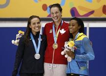 Jul 14, 2015; Toronto, Ontario, CAN; Natalie Coughlin of the United States (left) , Chantal Van LAndeghem of Canada (middle) and Arianna Vanderpool-Wallace of the Bahamas on the podium after the women's 100m freestyle swimming final during the 2015 Pan Am Games at Pan Am Aquatics UTS Centre and Field House. Mandatory Credit: Rob Schumacher-USA TODAY Sports