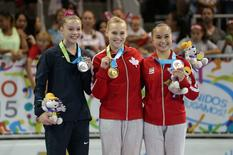 Megan Skaggs of the United States (left) , Ellie Black of Canada (middle) and Victoria Woo of Canada (right) pose on the podium after the women's gymnastics balance beam final during the 2015 Pan Am Games at Toronto Coliseum. Matt Detrich-USA TODAY Sports