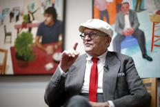 "British artist David Hockney is interviewed in front of his painting ""The Group V"" (R) and photographic drawing ""The Red Table"" at a preview of his exhibition ""Painting and Photography"" at the L.A. Louver gallery in Venice, Los Angeles, California, United States July 15, 2015. REUTERS/Lucy Nicholson"