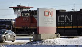A locomotive moves through the Canadian National (CN) railyards in Edmonton February 22, 2015. REUTERS/Dan Riedlhuber