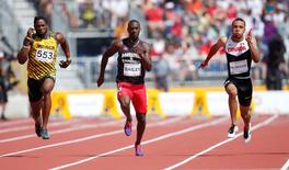 Jul 21, 2015; Toronto, Ontario, CAN; From left Jason Livermore of Jamaica , Daniel Bailey of Antigua and Andre De Grasse of Canada race in a men's athletics 100m preliminary heat during the 2015 Pan Am Games at CIBC Pan Am Athletics Stadium. Mandatory Credit: Erich Schlegel-USA TODAY Sports