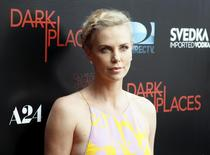"Cast member Charlize Theron arrives for the Los Angeles premiere of A24 and DirectTV's ""Dark Places"" in Los Angeles, July 21, 2015. REUTERS/Danny Moloshok"