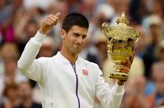 Men's Singles - Serbia's Novak Djokovic celebrates with the trophy after winning the final Mandatory Credit: Action Images / Tony O'Brien Livepic
