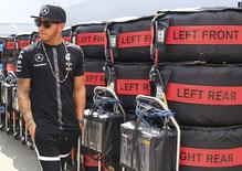 Mercedes Formula One driver Lewis Hamilton of Britain walks before a news conference ahead of the Hungarian F1 Grand Prix at the Hungaroring circuit, near Budapest, Hungary July 23, 2015. REUTERS/Bernadett Szabo