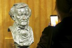 A visitor takes a picture of a bust of German composer Richard Wagner at the Richard Wagner Museum in Bayreuth, Germany, July 24, 2015. EDITORIAL USE ONLY. NOT FOR SALE FOR MARKETING OR ADVERTISING CAMPAIGNS. REUTERS/Michael Roddy