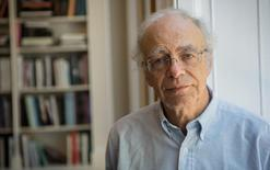 """Australian philosopher Peter Singer poses for an portrait at Yale University Press office to promote his new book """"The Most You Can Do"""", in London, Britain, June 11, 2015.  THOMSON REUTERS FOUNDATION/Tristan Martin"""