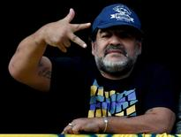 Former Argentine soccer player Diego Maradona gestures from a balcony as he attends the Argentine First Division soccer match between Boca Juniors and Quilmes at La Bombonera stadium in Buenos Aires July 18, 2015.   REUTERS/Marcos Brindicci