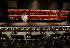 A waiter works in a bar at First Cabin hotel, which was converted from an old office building, in Tokyo, July 3, 2015. REUTERS/Toru Hanai