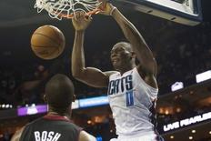 Charlotte Bobcats center Bismack Biyombo (0) dunks the ball during the second half against the Miami Heat in game four of the first round of the 2014 NBA Playoffs at Time Warner Cable Arena. The Heat defeated the Bobcats 109-98. Mandatory Credit: Jeremy Brevard-USA TODAY Sports