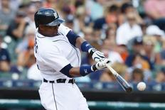 Jul 23, 2015; Detroit, MI, USA; Detroit Tigers left fielder Yoenis Cespedes (52) hits a double in the eighth inning against the Seattle Mariners at Comerica Park. Mandatory Credit: Rick Osentoski-USA TODAY Sports