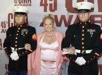 Country music singer Lynn Anderson, escorted by United States Marines, arrives at the 45th Country Music Association Awards in Nashville, Tennessee November 9, 2011. REUTERS/Harrison McClary