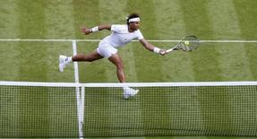 Rafael Nadal of Spain hits a shot during his match against Dustin Brown of Germany at the Wimbledon Tennis Championships in London, in this file photo taken on July 2, 2015. REUTERS/Suzanne Plunkett