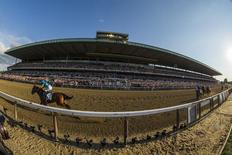 Jockey Victor Espinoza, aboard American Pharoah, rides after winning the 147th running of the Belmont Stakes as well as the Triple Crown, in Elmont, New York in this file photo taken on June 6, 2015. REUTERS/Lucas Jackson