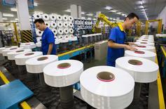 L'activité du secteur manufacturier chinois a subi en juillet une contraction plus marquée qu'estimé initialement, la plus forte depuis deux ans, sur fond de baisse des commandes, selon les résultats définitifs de l'enquête mensuelle Markit. /Photo prise le 13 juin 2015/REUTERS/China Daily