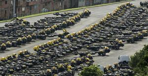 Parts of the new Mercedes-Benz trucks are seen at a parking lot close to the Mercedes-Benz factory in Sao Bernardo do Campo, Brazil, July 6, 2015. Automobile production in Brazil dropped 12.5 percent and sales slipped 0.1 percent in June from May, the national automakers' association (ANFAVEA), said on Monday. REUTERS/Paulo Whitaker - RTX1JA35