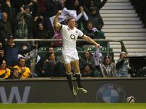 England's Chris Ashton celebrates scoring a try during their international rugby union match against Argentina at Twickenham in London November 9, 2013. REUTERS/Stefan Wermuth