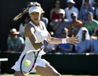 Eugenie Bouchard of Canada hits the ball during her match against Ying-Ying Duan of China at the Wimbledon Tennis Championships in London, June 30, 2015.  REUTERS/Toby Melville