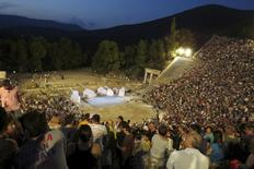 "Spectators are seen before a performance of Aristophanes' 2,400-year-old play ""Ecclesiazusae"" (The Assembly Women) at the ancient Greek amphitheatre of Epidaurus, southern Greece August 1, 2015. While cash-strapped Greeks forgo the cinema and other luxuries, theatre ticket sales are booming -- even if theatres struggle to cover their costs and actors often go unpaid. Picture taken August 1, 2015. REUTERS/Lefteris Karagiannopoulos"