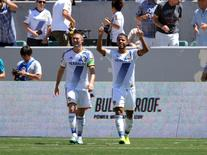 August 9, 2015; Carson, CA, USA; Los Angeles Galaxy midfielder/forward Giovani Dos Santos (10) celebrates with forward Robbie Keane (7) his goal scored against Seattle Sounders during the second half at StubHub Center. Mandatory Credit: Gary A. Vasquez-USA TODAY Sports