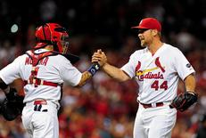 Aug 11, 2015; St. Louis, MO, USA; St. Louis Cardinals relief pitcher Trevor Rosenthal (44) celebrates with catcher Yadier Molina (4) after defeating the Pittsburgh Pirates at Busch Stadium. Jeff Curry-USA TODAY Sports
