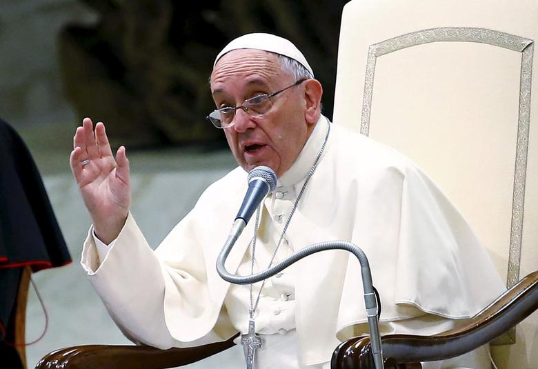 Pope Francis gestures as he talks during a special audience with members of ''Eucharist Youth Movement'' in Paul VI hall at the Vatican, in this August 7, 2015 file photo.  REUTERS/Tony Gentile/Files