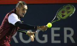 Aug 12, 2015; Montreal, Quebec, Canada;  Nick Kyrgios of Australia hits a shot against Stan Wawrinka of Switzerland (not pictured) during the Rogers Cup tennis tournament at Uniprix Stadium. Mandatory Credit: Jean-Yves Ahern-USA TODAY Sports