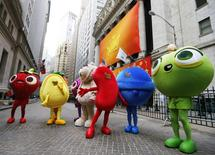 """Mascots dressed as characters from the mobile video game """"Candy Crush Saga"""" pose outside the New York Stock Exchange March 26, 2014.   REUTERS/Brendan McDermid"""